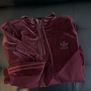 Beautiful burgundy velvet Adidas jogging jacket.